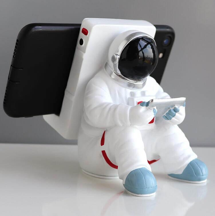 Support pour téléphone astronaute assis - vue de face