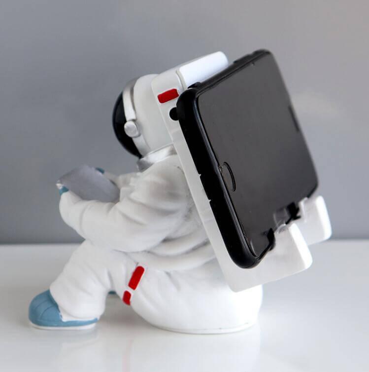 Support téléphone astronaute assis - vue de dos