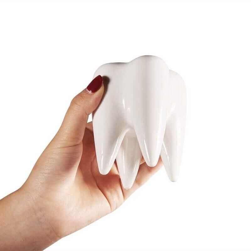Pot en forme de dent