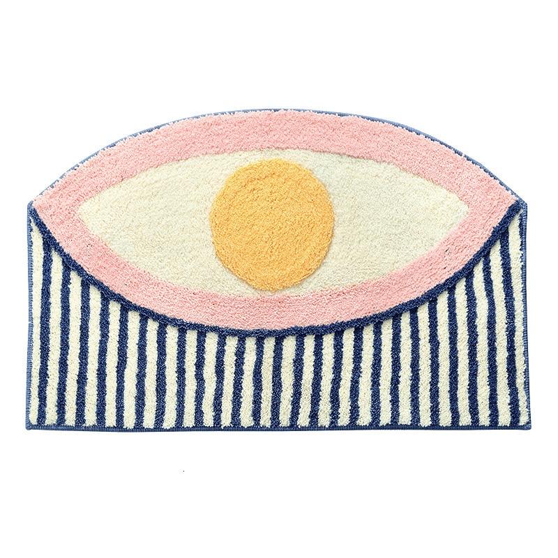 Tapis géométrique oeil sur fond blanc