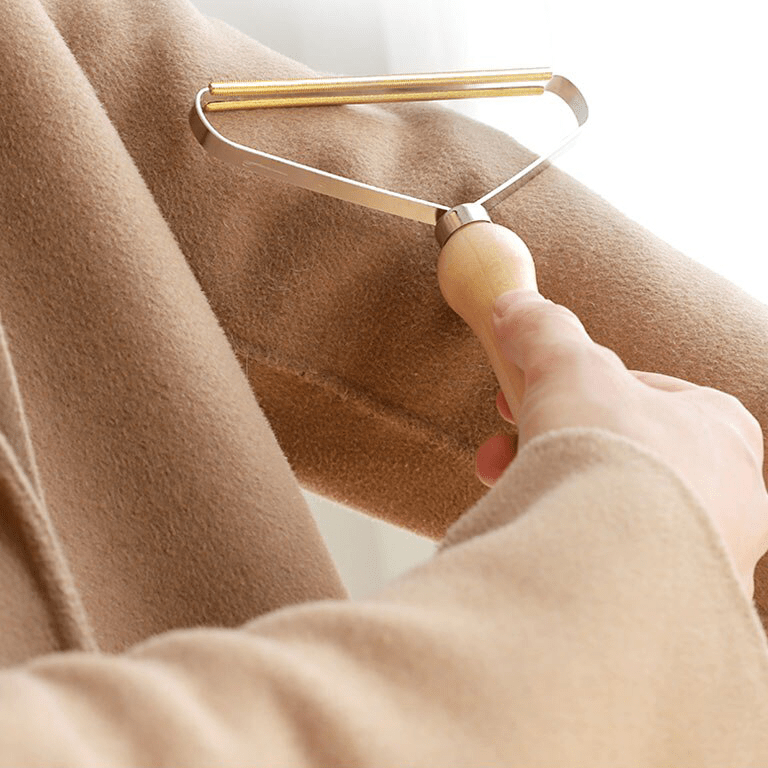Rasoir anti-bouloche sur la laine