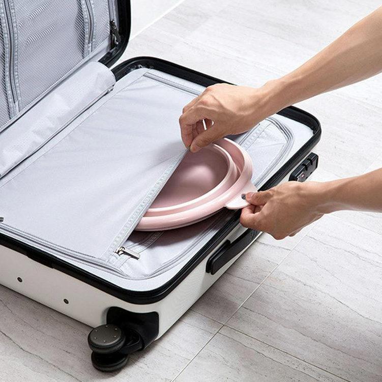 bassine pliable dans une valise
