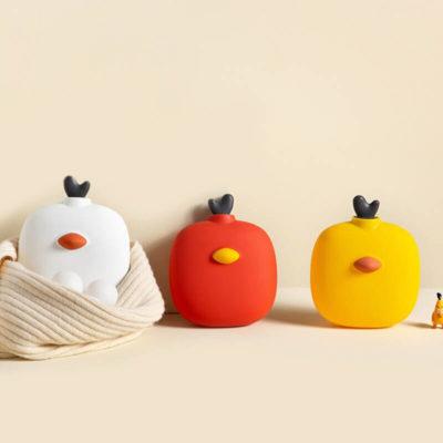 Trois bouillottes peluches en forme de poussin